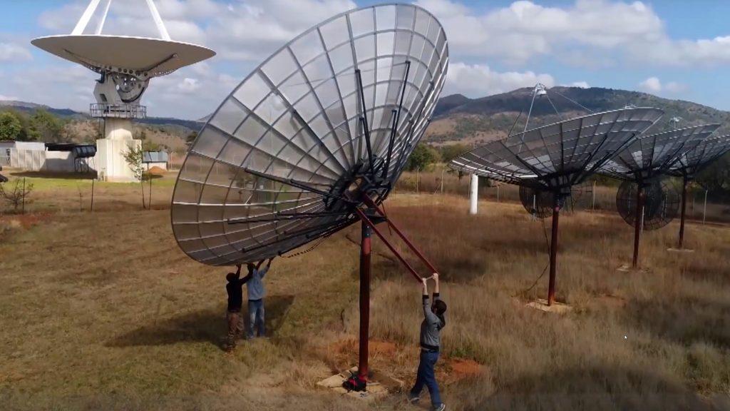 man pulling up satelit drone footage video